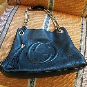 Black leather Gucci purse